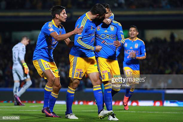 Ismael Sosa of Tigres celebrate with teammates after scoring the first goal of his team during the quarter finals first leg match between Pumas UNAM...