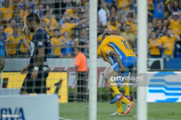Ismael Sosa of Tigres celebrates with teammate Andre Gignac after scoring his team's first goal during the 14th round match between Tigres UANL and...