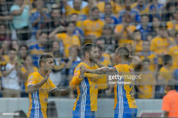 Ismael Sosa of Tigres celebrates with teammates after scoring his team's first goal during the 14th round match between Tigres UANL and Pumas UNAM as...