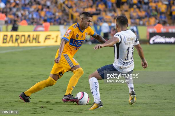 Ismael Sosa of Tigres fights for the ball with Bryan Rabello of Pumas during the 5th round match between Tigres and Pumas as part of the Torneo...