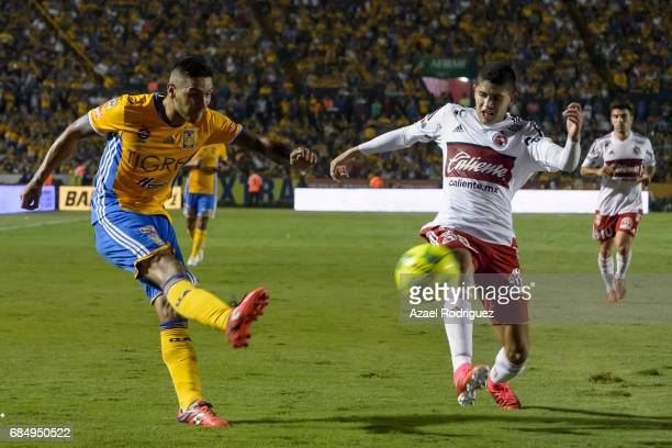 Ismael Sosa of Tigres fights for the ball with Carlos Vargas of Tijuana during the semi finals first leg match between Tigres UANL and Tijuana as...