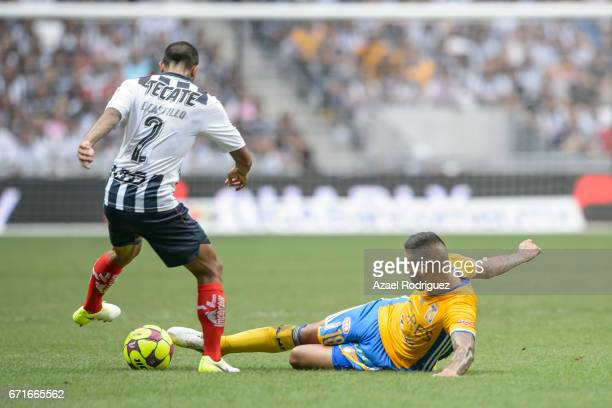 Ismael Sosa of Tigres fights for the ball with Edgar Castillo of Monterrey during the 15th round match between Monterrey and Tigres UANL as part of...
