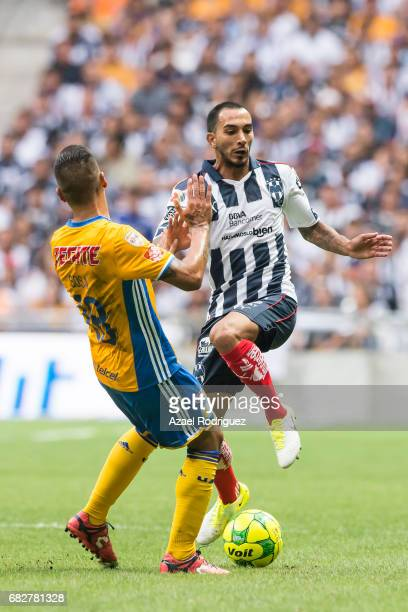 Ismael Sosa of Tigres fights for the ball with Edgar Castillo of Monterrey during the quarter finals second leg match between Monterrey and Tigres...