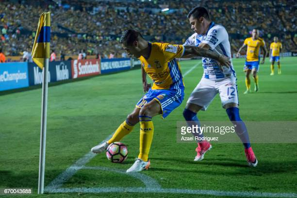 Ismael Sosa of Tigres fights for the ball with Emmanuel Garcia of Pachuca during the Final first leg match between Tigres UANL and Pachuca as part of...