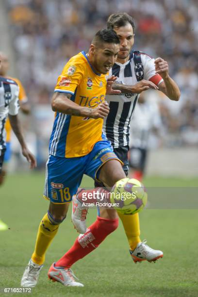 Ismael Sosa of Tigres fights for the ball with Jesus Maria Basanta of Monterrey during the 15th round match between Monterrey and Tigres UANL as part...