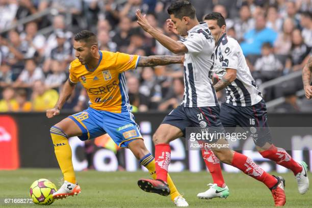 Ismael Sosa of Tigres fights for the ball with Jesus Molina of Monterrey during the 15th round match between Monterrey and Tigres UANL as part of the...