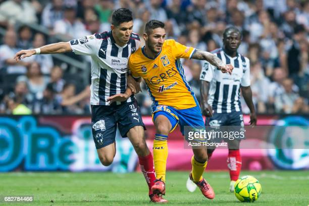 Ismael Sosa of Tigres fights for the ball with Jesus Molina of Monterrey during the quarter finals second leg match between Monterrey and Tigres UANL...