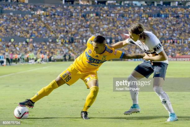 Ismael Sosa of Tigres fights for the ball with Jose Garcia of Pumas during the 5th round match between Tigres and Pumas as part of the Torneo...