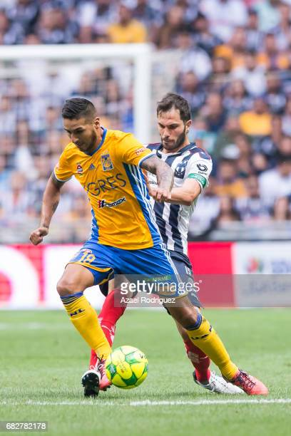 Ismael Sosa of Tigres fights for the ball with Jose Maria Basanta of Monterrey during the quarter finals second leg match between Monterrey and...
