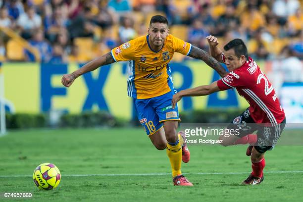 Ismael Sosa of Tigres fights for the ball with Juan Nunez of Tijuana during the 16th round match between Tigres UANL and Tijuana as part of the...