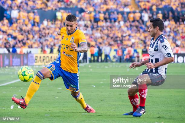 Ismael Sosa of Tigres fights for the ball with Luis Fuentes of Monterrey during the quarter finals first leg match between Tigres UANL and Monterrey...