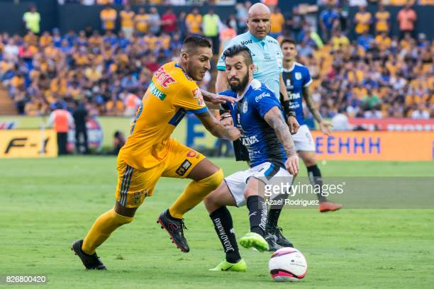 Ismael Sosa of Tigres fights for the ball with Marco Jimenez of Queretaro during the 3rd round match between Tigres UANL and Puebla as part of the...