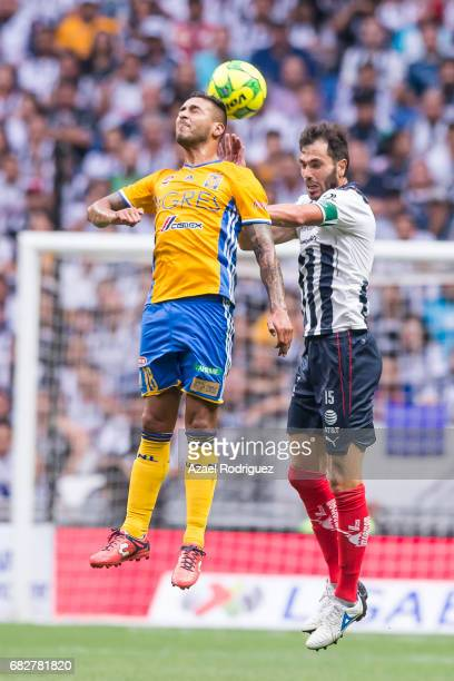 Ismael Sosa of Tigres heads the ball with Jose Maria Basanta of Monterrey during the quarter finals second leg match between Monterrey and Tigres...