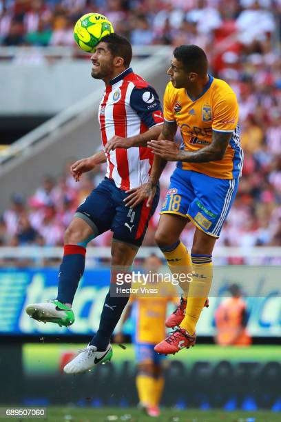 Ismael Sosa of Tigres jumps for the ball with Jair Pereira of Chivas during the Final second leg match between Chivas and Tigres UANL as part of the...