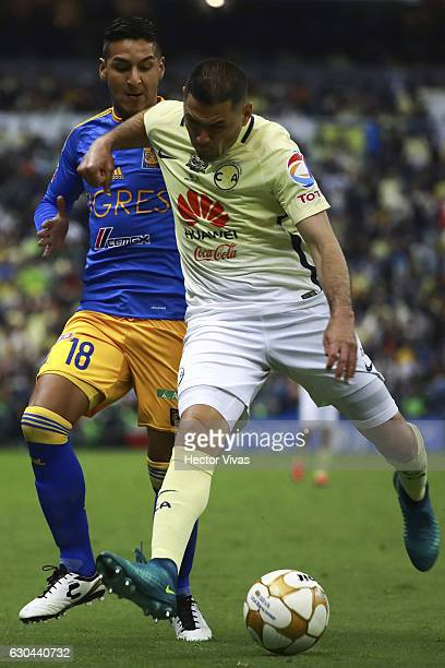 Ismael Sosa of Tigres struggles for the ball with Pablo Aguilar of America during the Final first leg match between America and Tigres UANL as part...
