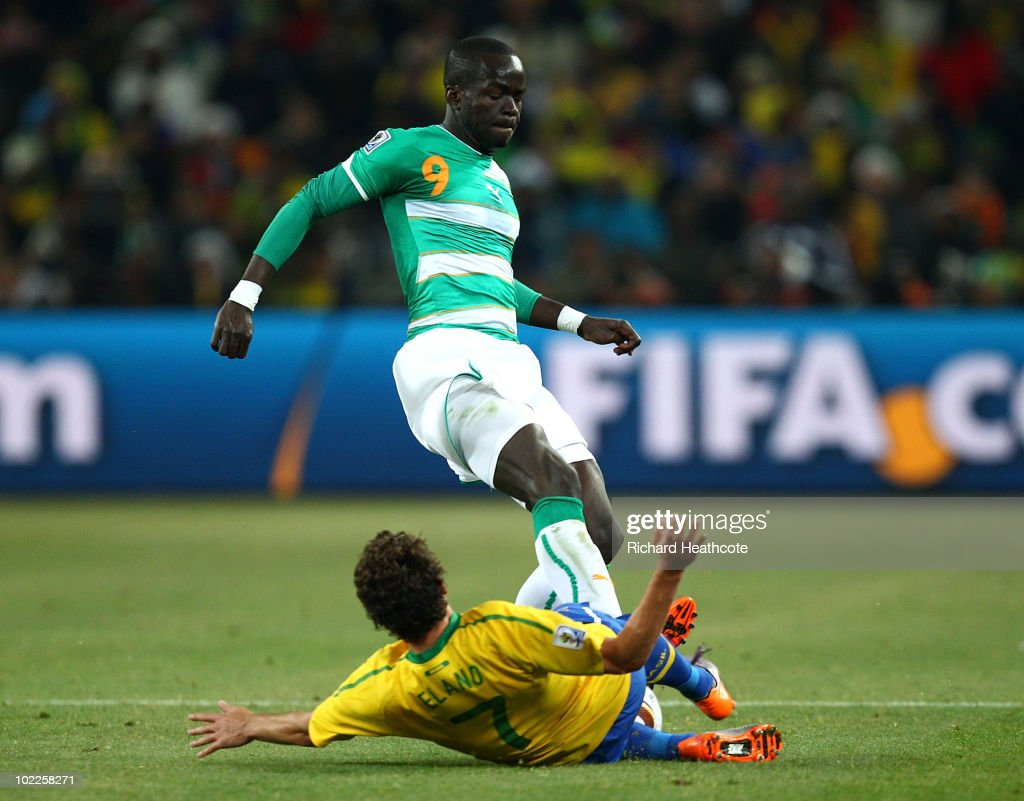 Ismael Tiote of Ivory Coast tackles Elano of Brazil which sees Elano stretchered off during the 2010 FIFA World Cup South Africa Group G match between Brazil and Ivory Coast at Soccer City Stadium on June 20, 2010 in Johannesburg, South Africa.