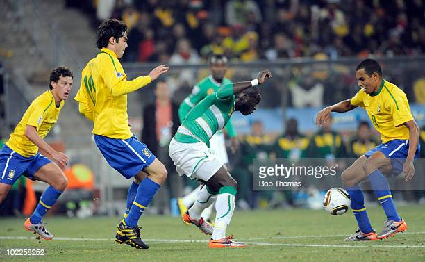 Ismael Tiote of the Ivory Coast goes between Kaka and Gilberto Silva of Brazil during the 2010 FIFA World Cup South Africa Group G match between...
