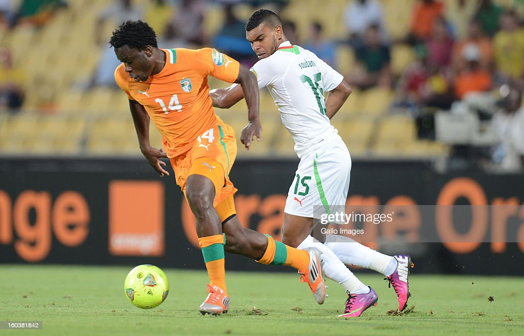 Ismael Traore of Ivory Coast competes with El Arabi Soudani of Algeria during the 2013 African Cup of Nations match between Algeria and Ivory Coast at Royal Bafokeng Stadium on January 30, 2013 in Rustenburg, South Africa.
