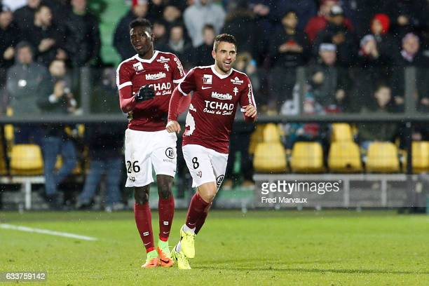 Ismaela Sarr of Metz and Yann Jouffre of Metz celebrates scoring his goal during the Ligue 1 match between FC Metz and Olympique de Marseille at...