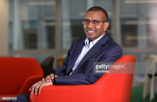 Ismail Ahmed founder and chief executive officer of WorldRemit Ltd poses for a photograph in London UK on Tuesday May 2 2017 Refugee economist...