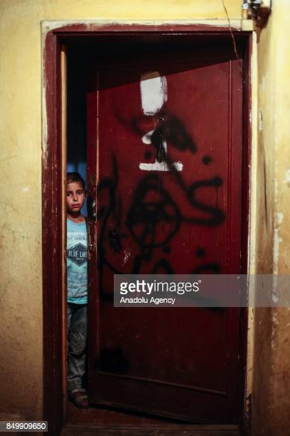 Ismail Ahmed looks behind of a half way open door in Altindag district of Ankara Turkey on July 26 2017 Ismail Ahmed lost his father in an airstrike...