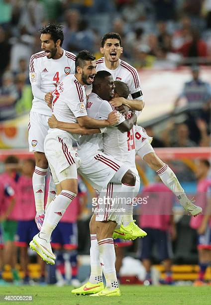 Ismail Ahmed of the United Arab Emirates celebrates with team mates after scoring the winning penalty during the 2015 Asian Cup Quarter Final match...