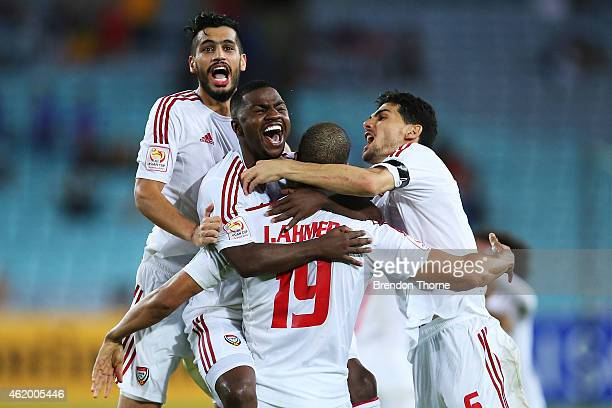Ismail Ahmed of the United Arab Emirates celebrates with team mates after scoring the winning goal in a penalty shoot out during the 2015 Asian Cup...