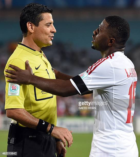Ismail Al Hammadi of the United Arab Emirates talks to referee Alireza Faghani of Iran during the quarterfinal football match between Japan and UAE...