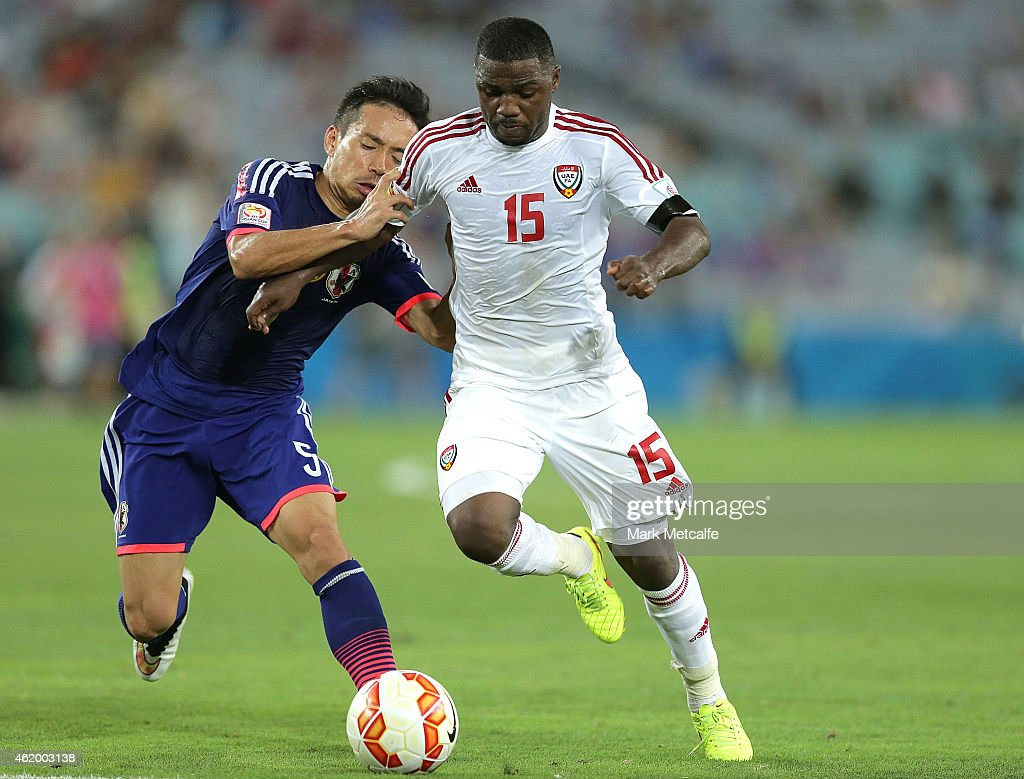 Ismail Al of the United Arab Emirates competes with Yuto Nagatomo of Japan during the 2015 Asian Cup Quarter Final match between Japan and the United Arab Emirates at ANZ Stadium on January 23, 2015 in Sydney, Australia.