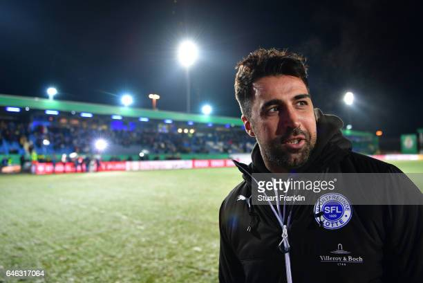 Ismail Atalan head coach of Lotte looks on the pitch as the game is called off due to an unplayable pitch prior to the DFB Cup quarter final between...