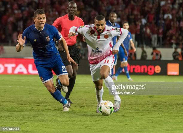 Ismail El Hadad of Wydad Casablanca in action against Saad Samir of Al Ahly during the CAF African Champions League match Wydad Casablanca and Al...