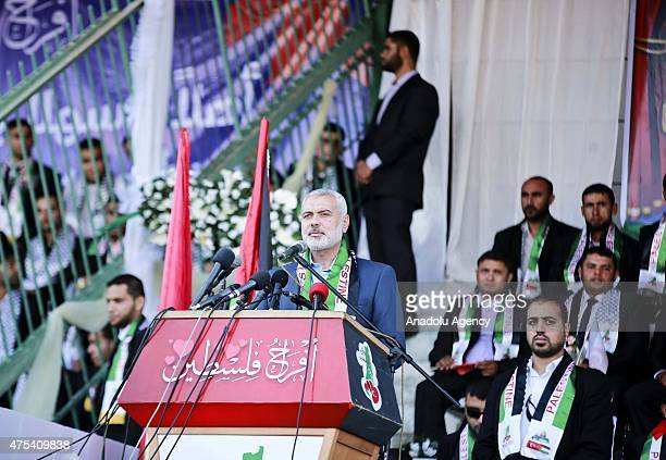 Ismail Haniyeh deputy head of Hamas' political office gives a speech during a mass wedding ceremony at the Yarmouk Stadium in Gaza on May 31 2015 Two...