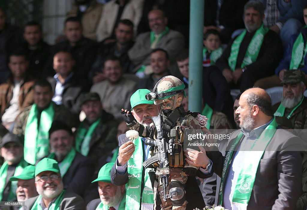 Ismail Haniyeh (R 3), head of the Hamas political wing, hold a boy in soldier costume during the graduation ceremony of Izz ad-Din al-Qassam Brigades, military wing of Hamas, held at the Yarmouk Stadium in Gaza City, Gaza on January 29, 2015. 17,000 young men graduate in a ceremony at Gaza's Yarmouk Stadium after completing training with the military wing of Hamas, the Izz ad-Din al-Qassam Brigades.