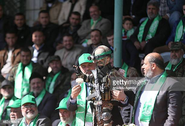 Ismail Haniyeh head of the Hamas political wing hold a boy in soldier costume during the graduation ceremony of Izz adDin alQassam Brigades military...