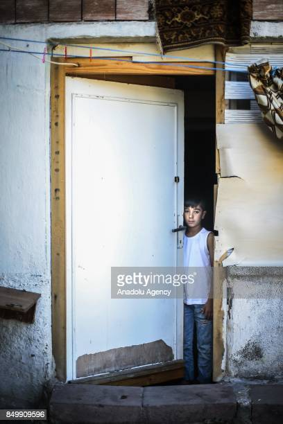 Ismail Ibrahim looks behind of a half way open door in Altindag district of Ankara Turkey on July 26 2017 Ismail Ibrahim lost his father in an...