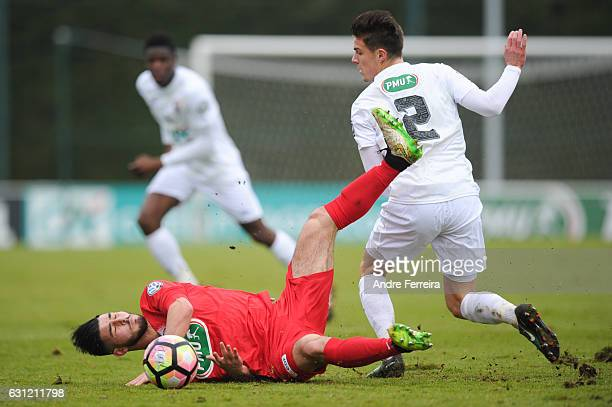 Ismail In of Sainte Genevieve and Frederic Guilbert of Caen during the French National Cup match between Sainte Genevieve and SM Caen round of 64 on...