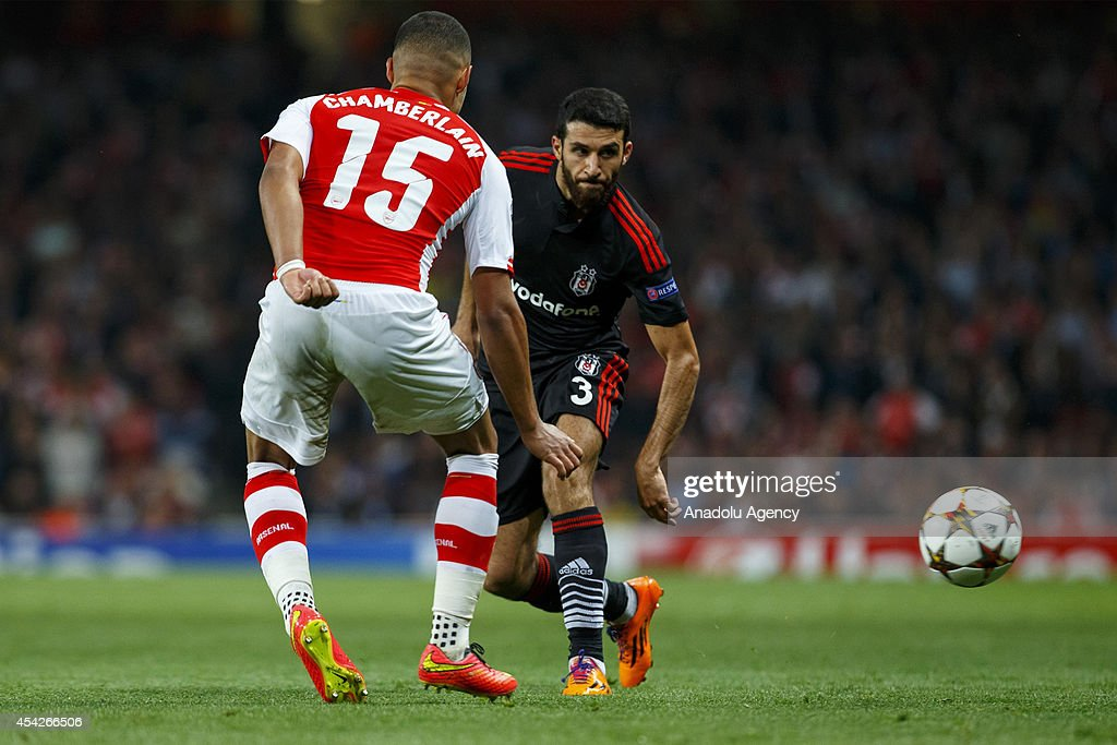 Ismail Koybai (R) of Besiktas and Arsenal's Alex Oxlade-Chamberlain (L) vie for the ball during the UEFA Champions League play-off second leg match between Arsenal and Besiktas at Emirates Stadium on August 27, 2014 in London, England.