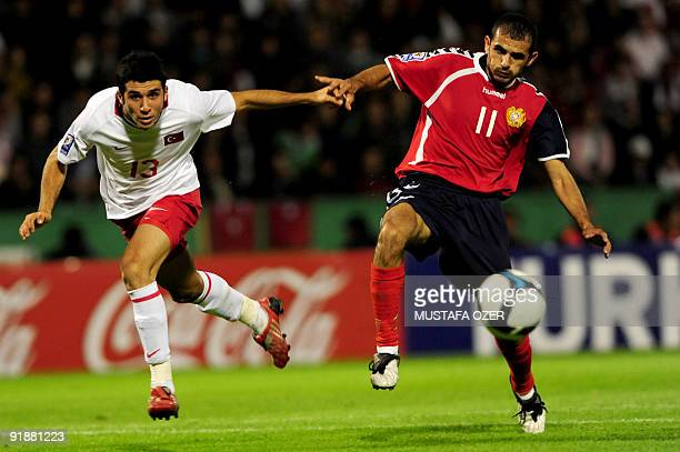 Ismail Koybasi of Turkey vies for the ball with Arman Karamyan of Armenia during their World Cup 2010 qualifying football match at the Ataturk...