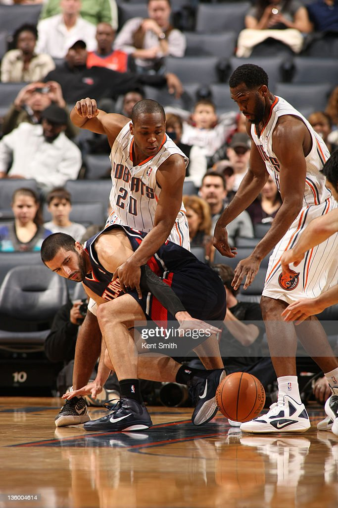Ismail Muhammed #20 of the Charlotte Bobcats blocks a pass to the Atlanta Hawks on December 19, 2011 during the preseason game at the Time Warner Cable Arena in Charlotte, North Carolina.