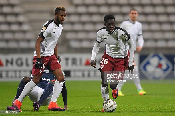 Ismaila Sarr of Metz and Cheick Doukoure of Metz during the League Cup match between Paris FC and FC Metz on October 26 2016 in Paris France