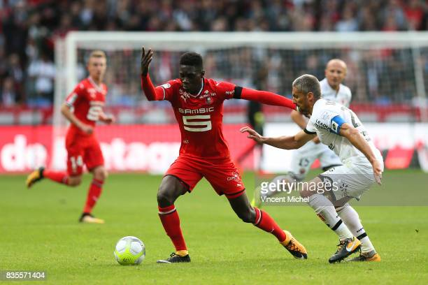Ismaila Sarr of Rennes and Cedric Varrault of Dijon during the Ligue 1 match between Stade Rennais and Dijon FCO at Roazhon Park on August 19 2017 in...