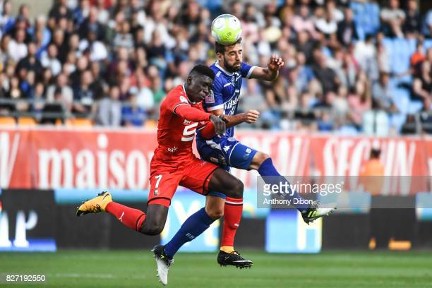Ismaila Sarr of Rennes and Mathieu Deplagne of Troyes during the Ligue 1 match between Troyes AC and Stade Rennais at Stade de l'Aube on August 5...