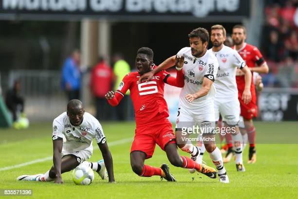 Ismaila Sarr of Rennes and Oussama Hadadi of Dijon during the Ligue 1 match between Stade Rennais and Dijon FCO at Roazhon Park on August 19 2017 in...