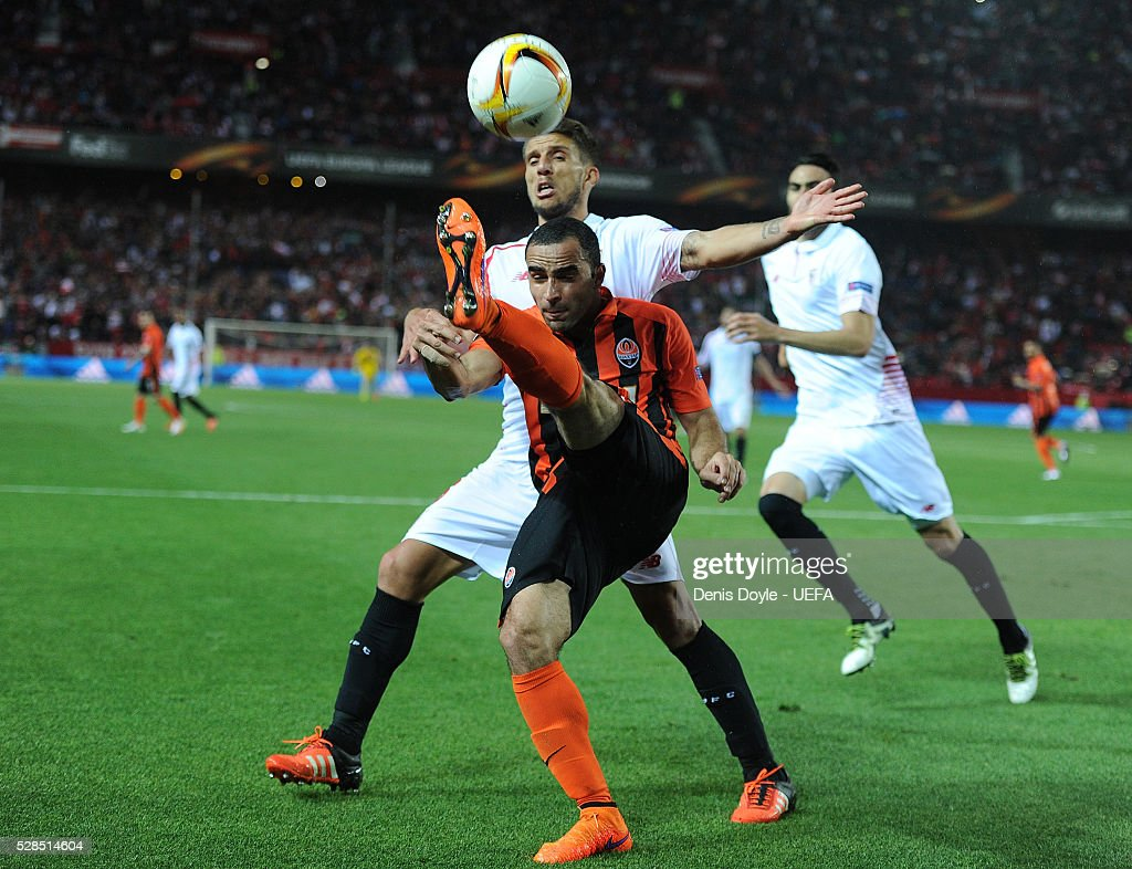 Ismaily of Shakhtar Donetsk clears the ball from Daniel Carrico of Sevilla during the UEFA Europa League Semi Final second leg match between Sevilla and Shakhtar Donetsk at the Sanchez Pizjuan stadium on May 5, 2016 in Seville, Spain.
