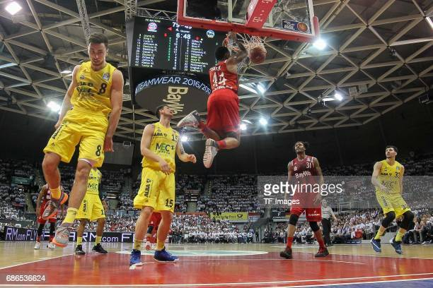 Ismet Akpinar of Berlin und Bryce Taylor of Munich battle for the ball during the easyCredit BBL Basketball Bundesliga match between FC Bayern...