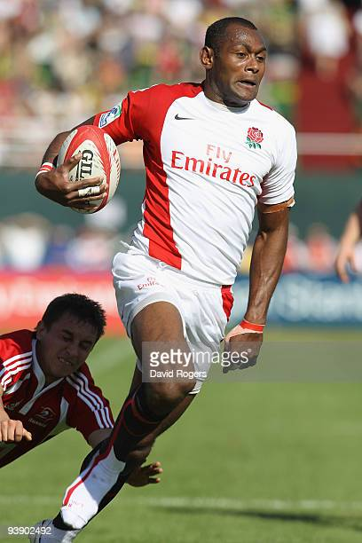 Isoa Damu of England races away to score a try against Russia during the IRB Sevens tournament at the Dubai Sevens Stadium on December 4 2009 in...