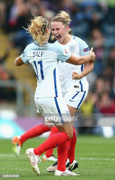Isobel Christiansen of England is congratulated by team mate Rachel Daly after scoring a goal during the UEFA Women's European Championship...