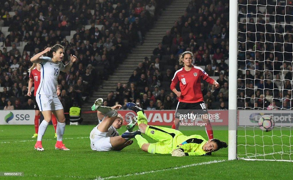 Isobel Christiansen of England (C) scores their third goal past goalkeeper Manuela Zinsberger of Austria during the Women's International Friendly match between England and Austria at Stadium mk on April 10, 2017 in Milton Keynes, England.