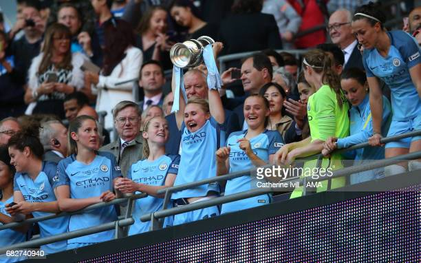 Isobel Christiansen of Manchester City Women celebrates with the trophy during the SSE Women's FA Cup Final between Birmingham City Ladies and...