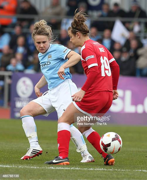 Isobel Christiansen of Manchester City Women plays the past Jemma Rose of Bristol Academy Women during the FA WSL1 match between Manchester City...